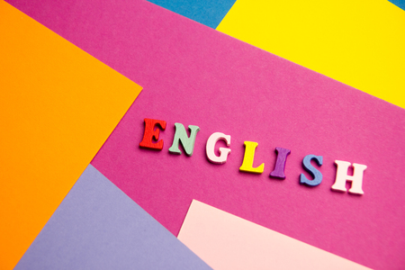 English word composed from colorful abc alphabet block wooden letters, copy space for ad text. Education concept. Stock Photo
