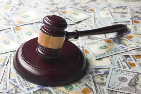 Judges Or Auctioneer Gavel On The Dollar Cash Background, Concept For Corruption, Bankruptcy, Auction Bidding, Fines