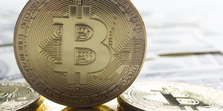 Golden bitcoin with dollar background. conceptual image for crypto currency.