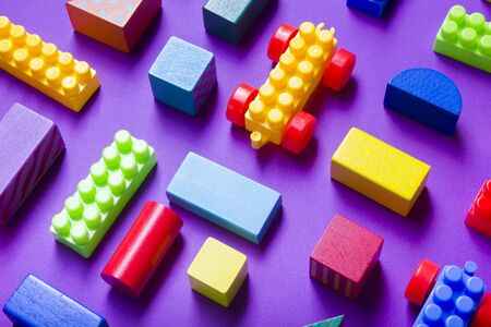 Colorful kids toys frame on wooden background. Top view. Flat lay. Copy space for text. Imagens