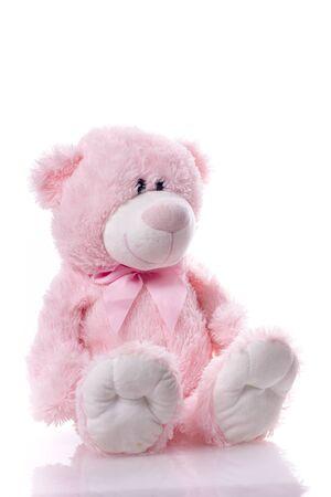 Hermoso lindo oso de peluche rosa aislado sobre fondo blanco.