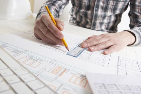 Architects working on blueprint, real estate project. Architect workplace. Construction concept. Engineering tools.