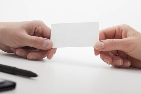 business executive exchanging business card blank. Copy space Imagens