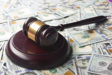 Judges Or Auctioneer Gavel On The Dollar Cash Background, Top View, Close-Up. Concept For Corruption, Bankruptcy, Bail, Crime, Bribing, Fraud, Auction Bidding, Fines.