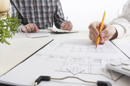 Architects working on blueprint, real estate project. Architect workplace. Construction concept. Engineering tools. Zdjęcie Seryjne