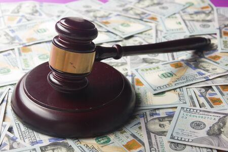 Judges Or Auctioneer Gavel On The Dollar Cash Background, Top View, Close-Up. Concept For Corruption, Bankruptcy, Bail, Crime, Bribing, Fraud, Auction Bidding, Fines Stockfoto