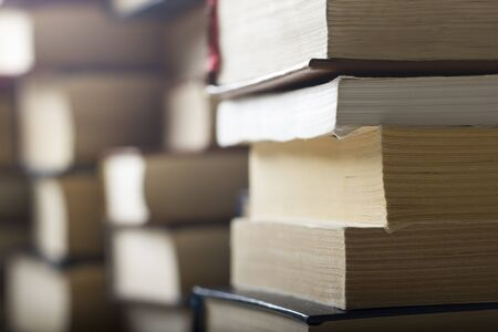 Stack of books background. many books piles Banco de Imagens