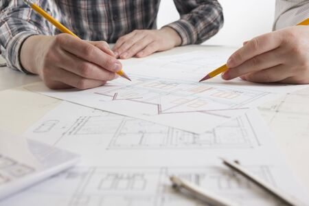 Architects working on blueprint. Architects workplace - architectural project, blueprints, ruler, calculator, laptop and divider compass. Construction concept. Engineering tools. Stok Fotoğraf