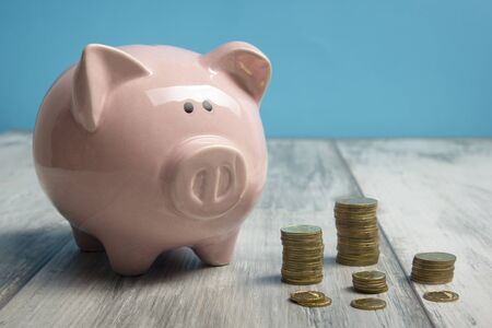 Piggy bank isolated on yellow background.