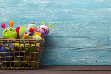 Colorful kids toys frame on wooden background. Top view. Flat lay. Copy space for text. Stok Fotoğraf