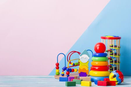 Baby toys on wooden table. Child development concept. Copy space for text Stok Fotoğraf