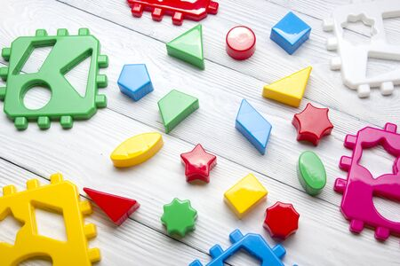 Kids educational developing toys frame on white background. Top view. Flat lay. Copy space for text. Stok Fotoğraf