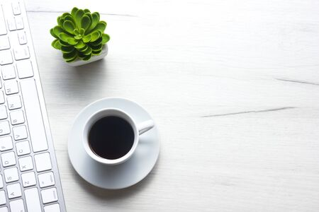 White desk office with laptop, smartphone and other work supplies with cup of coffee. Top view with copy space for input the text. Designer workspace on desk table essential elements on flat lay. Reklamní fotografie