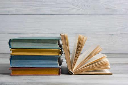 Open book, hardback books on wooden table. Back to school. Copy space Archivio Fotografico