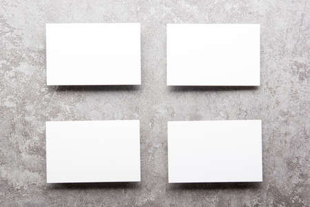 White business cards blank on textured background. Identity design, corporate templates, company style. Flat lay