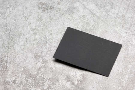 Black business cards blank on textured background. Identity design, corporate templates, company style. Flat lay