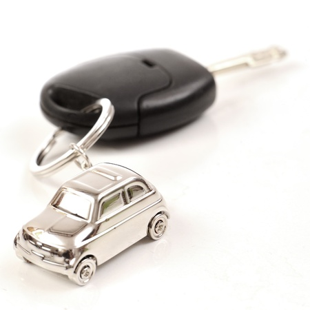silver sports car: Key car with little key ring in cars shape