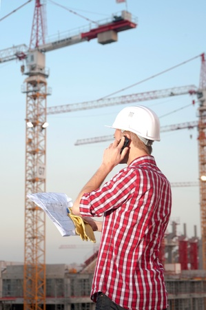Architect working outdoors on a construction site Stock Photo