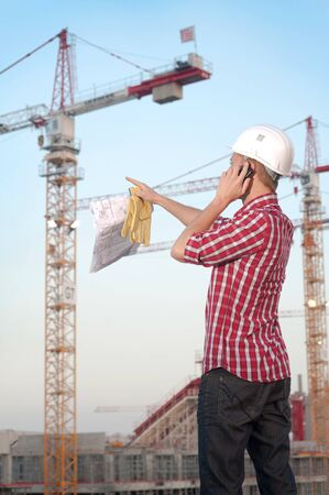 Architect working outdoors on a construction site photo