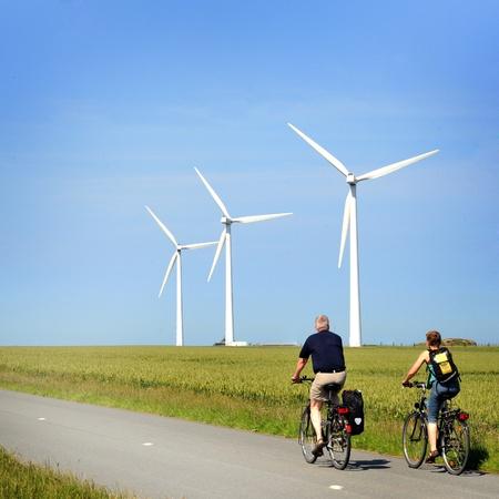 windturbines and bikers Stock Photo