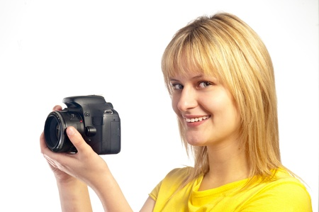 shootting: Young smiling girl with a dslr camera