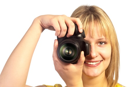 Young smiling girl with a dslr camera