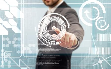 Business men touching a futuristic touchscreen interface photo