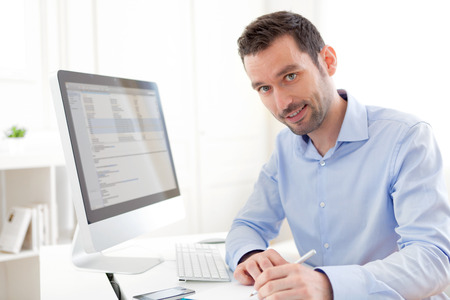 View of a Young business man working at home Stock Photo