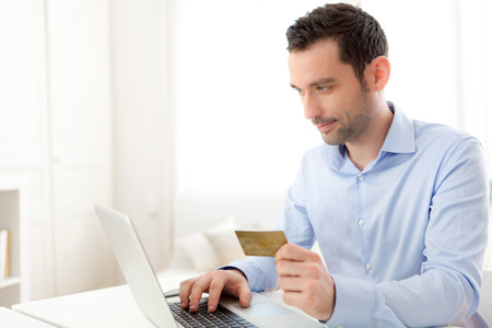 View of a Young business man paying online with credit card  photo