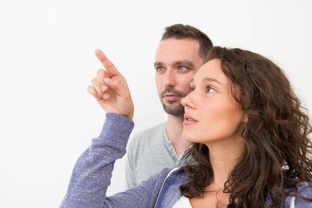 Couple using imaginary touchscreen interface Stock fotó