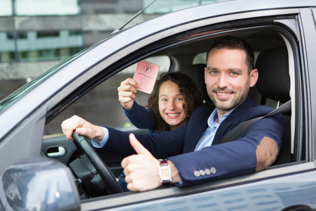 licence: View of a Driver in his car after getting his driving licence Stock Photo