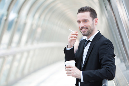 having a break: View of an attractive businessman having a break Stock Photo