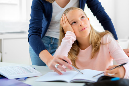 View of a Young girl encounter difficulties during homework