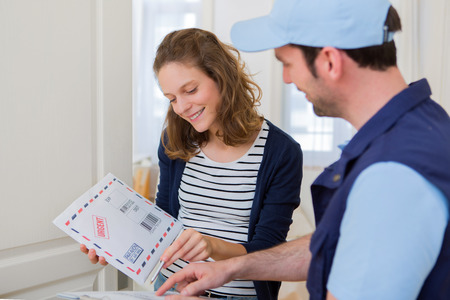 registered: View of a Delivery man handing over a registered mail