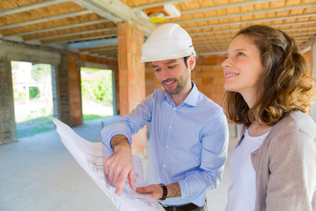View of a Young woman and architect on construction site