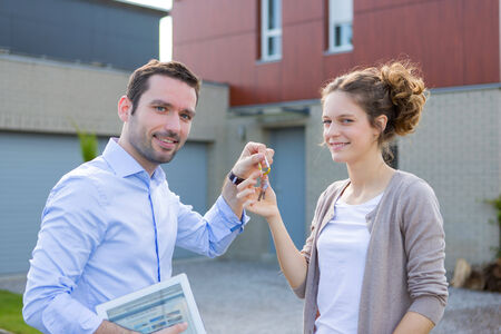 View of a Real estate agent handing over keys  photo