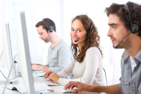 View of a Young attractive woman working in a call center Banco de Imagens