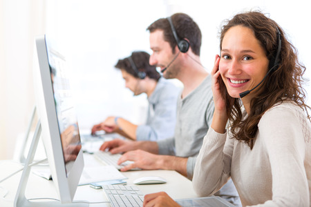 View of a Young attractive woman working in a call center Banque d'images