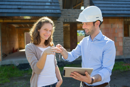 View of a Young woman and architect on construction site photo