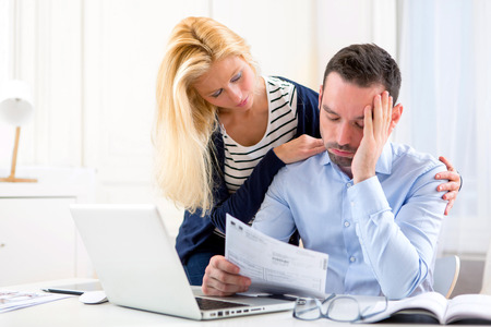 View of an Attractive couple doing administrative paperwork