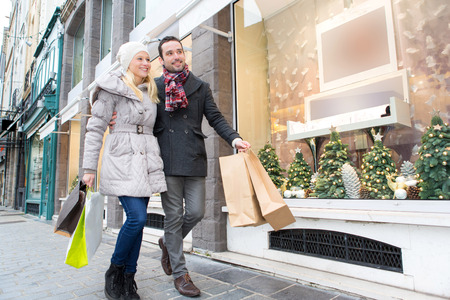 View of a Young attractive couple with shopping bags Stock Photo