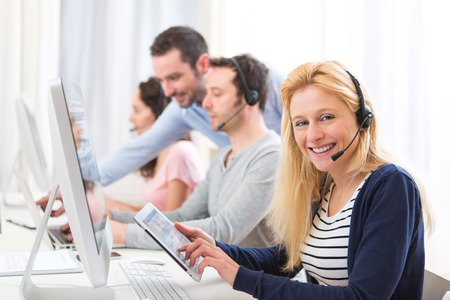 customer assistant: View of a Young attractive woman working in a call center Stock Photo