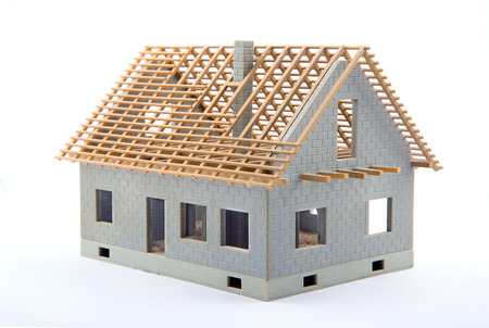concrete in construction: View of a House miniature under construction on an architect desk Stock Photo