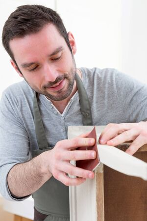 refurbish: View of a Young attractive carpenter working in his workshop Stock Photo