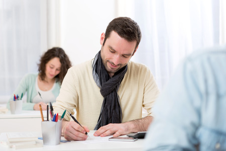 exam: View of a Young attractive man taking competitive exam Stock Photo