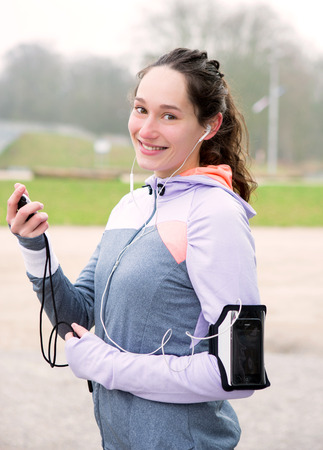 chronometer: View of a Young attractive woman checking a chronometer durng a running session