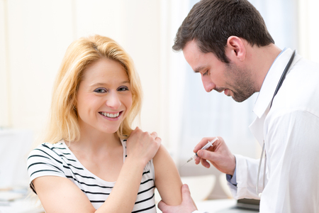 View of a Young attractive woman being vaccinated 版權商用圖片