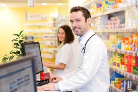 View of an attractive pharmacist team at work Banco de Imagens