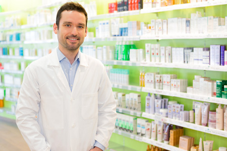 pharmacy pills: View of an attractive pharmacist at work
