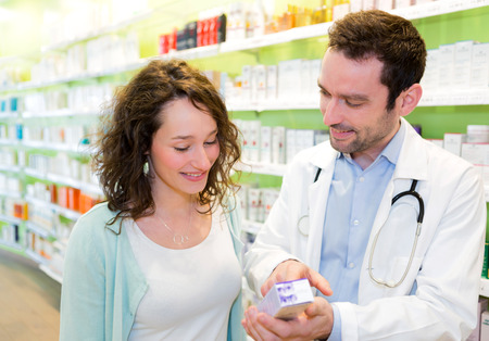 pharmacist: VIew of an Attractive pharmacist advising a patient